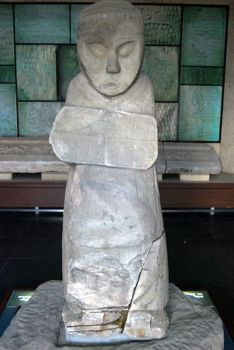 Jicheng (Beijing) - Statue of man holding shield from an Eastern Han Dynasty tomb discovered in the river bed of the Yongding River in Fengtai District to the west of Ji.