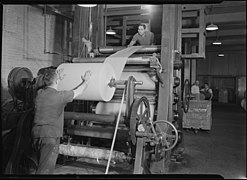 Holyoke, Massachusetts - Paper. American Writing Paper Co. Super-calender - putting on roll, starting operation. - NARA - 518330.jpg