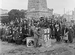 Hope Gibbons - Mayor of Wanganui, Hope Gibbons, placing soil from the battlefields of Belgium in the Wanganui Maori War Memorial on Anzac Day 1925