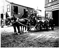 Horse-drawn hose cart and fire fighters in front of Madison St Firehouse -5, Seattle (CURTIS 1479).jpeg