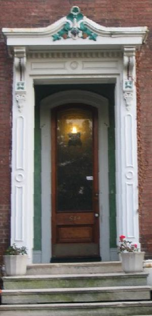 The front door of a house is often decorated t...