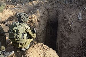 Palestinian tunnel warfare in the Gaza Strip - IDF soldier overlooking an uncovered tunnel in the Gaza Strip