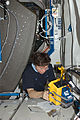 ISS-20 Michael Barratt works at a rotated rack in the Destiny lab.jpg