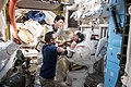 ISS-54 Norishige Kanai and Mark Vande Hei during spacesuit fit check.jpg