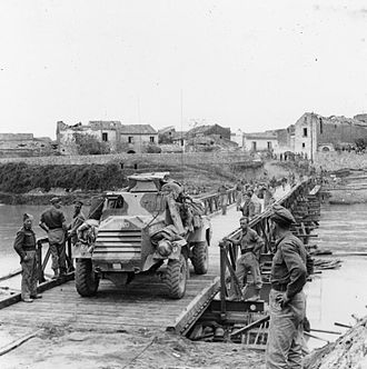 Otter Light Reconnaissance Car - An Otter crossing a Bailey bridge over the Volturno river at Grazzanise in October 1943
