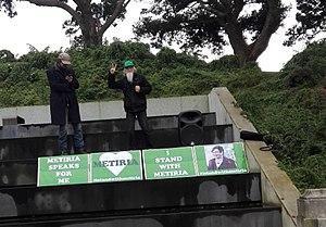 """Metiria Turei - Political activists with banners saying """"I stand with Metiria"""""""