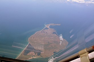 Île aux Chevaux - Île aux Chevaux is in the north end of the Grand Barachois, a lagoon between the islands of Le Cap and Miquelon, fewer than 100 meters off the southern shores of the latter. Its spit comes about 40 meters east of an easterly spit off the Miquelon southern coast.