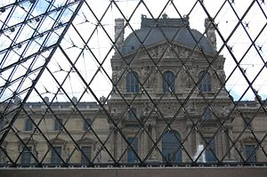 Louvre Palace - Inside the Pyramid: the view of the Louvre Museum in Paris from the underground lobby of the Pyramid.