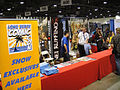 J Scott Campbell signs at the exclusives booth (5134033437).jpg