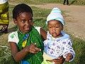 Jessica Kafuko-a girl taking a sibling to receive a net in Mwanza, Tanzania (22758497049).jpg