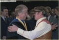 Jimmy Carter greets his brother, Billy Carter, at the commencement ceremonies at Georgia Institute of Technology in... - NARA - 183602.tif