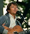 John Denver serenades the crowd (48591893031).jpg