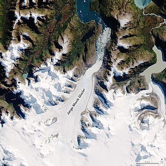 Jorge Montt Glacier - Jorge Montt glacier from Landsat, 2016. The glacier flows south to north and empties into a fjord (note icebergs) that turns west to the Pacific Ocean, offscreen. Click on image for further details.