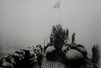 Japanese Special Attack Units - Kaiten manned torpedoes, stacked on top of a departing submarine