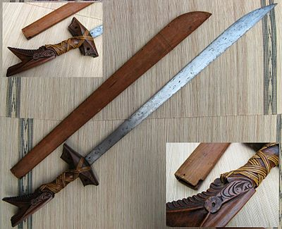 Kampilan from the Philippines. The traditional designs of the hilt is a notable depiction from Philippine mythology. Kampilan moro sword with sheath.jpg