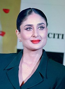 Kareena Kapoor smiling away from camera