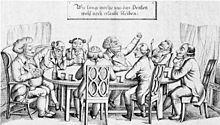 Une dizaine d'hommes, à l'évidence bourgeois, sont assis baillonnés autour d'une table. Au-dessus de la table sur panneau est écrit: «Combien de temps nous sera-il encore permis de penser?».