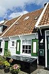 foto van Houten huis onder zadeldak