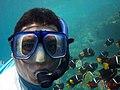Kid snorkeling with fish.jpg