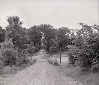 Kipling Avenue - Looking north up Kipling Ave. in 1955 towards the bridge over the west branch of the Humber River after it was washed out by Hurricane Hazel