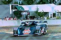 Kremer K8 - Derek Bell, Jurgen Lassig & Robin Donovan at the Ford Chicane at the 1994 Le Mans (31822380332).jpg