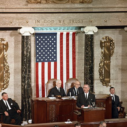 President pro tempore Carl Hayden seated to the left of House Speaker John W. McCormack during a 1963 speech by President Lyndon B. Johnson to a joint session of Congress. LBJ McCormack Hayden.jpg
