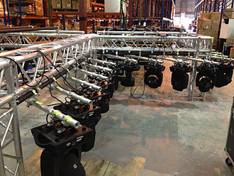 Stage lighting - Moving lights hanging on a truss, ready for rigging and chain motors.