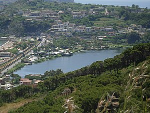 Lucrinus Lacus - Present-day lake looking southwest from Monte Nuovo; breakers on the Gulf of Pozzuoli are glimpsed at left, Lago d'Averno at upper right.