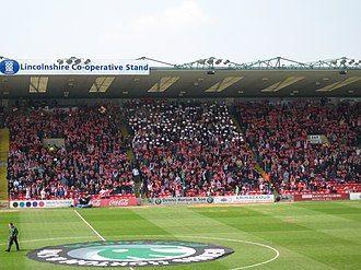 Lincoln City F.C. - Lincoln fans do a card display before a match against Swindon
