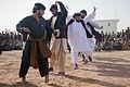 Local men dance outside of the Zhari District Center, Kandahar province, Afghanistan, Dec 111224-A-VB845-369.jpg