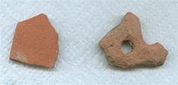 Pieces of red clay pottery.