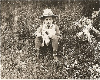 Ludwig Wittgenstein - Ludwig sitting in a field as a child