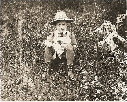 Ludwig sitting in a field as a child