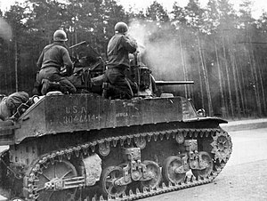 106th Cavalry Regiment - M5A1 Stuart Light Tank firing its 37 mm gun.