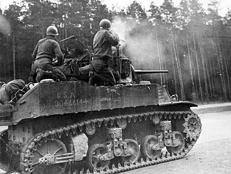 106th Cavalry Regiment - M5A1 Stuart Light Tank firing its 37 mm gun.