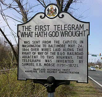 Baltimore–Washington telegraph line - Maryland state historical marker commemorating the first telegraph message, located between US Highway 1 and railroad tracks in Beltsville, Maryland.