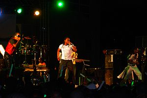 Machel Montano - Machel (center) performing on stage alongside Zan (left) and Farmer Nappy (right)