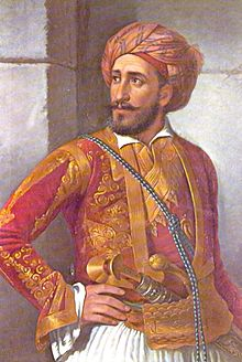 portrait d'homme barbu en veste rouge et or, portant un turban