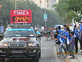 Male Marathoners lead car with 'TIMING'..JPG