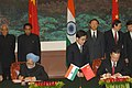 Manmohan Singh signing an agreement on 'A Shared Vision for the 21st Century of the Peoples of Republic of China and the Republic of India' with the Chinese Premier, Mr. Wen Jiabao, in Great Hall of People, Beijing in China.jpg