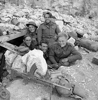 78th Infantry Division (United Kingdom) - Men of the 6th Battalion, Queen's Own Royal West Kent Regiment in a dugout on Monastery Hill at Monte Cassino, Italy, 26 March 1944.