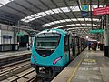 Metro train at majarajas metro station, Ernakulam, Kerala, India.jpg