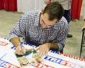 Michael Wacha signing autographs in Jan 2014.jpg