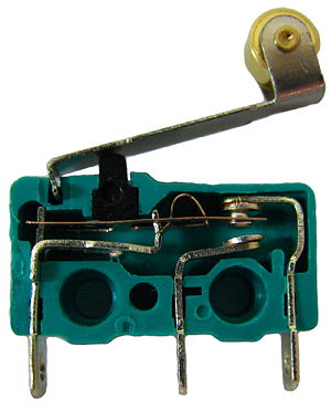 Miniature snap-action switch - The internals of a micro switch.  Contacts, from left to right, are common, normally open, and normally closed.