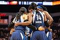 Minnesota Lynx teammates huddle on the court in the Lynx vs Sun game at Target Center.jpg