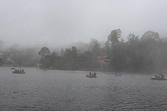 Kodaikanal Lake - Mist covering the boating in Kodaikanal Lake.