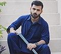 Mohammed bassit with a gun.jpg