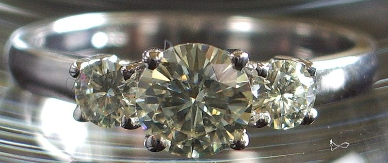 Synthetic diamonds [moissanite] in engagement ring