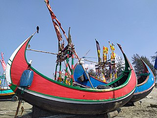 Moon boat at Teknaf sea beach 10.jpg