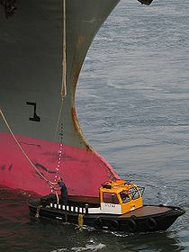 Mooring boat with container ship.jpg